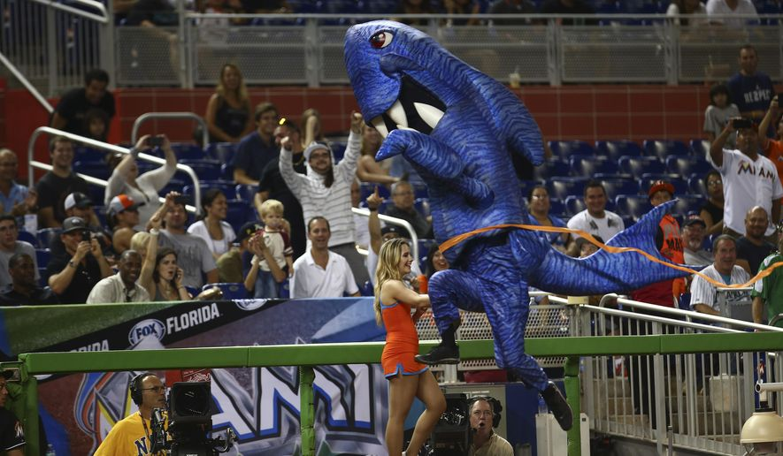 The Shark, one of the Miami Marlins' Sea Creatures, wins a race during the sixth inning of the Marlins' baseball game against the Philadelphia Phillies, Wednesday, Sept. 24, 2014, in Miami. (AP Photo/J Pat Carter)