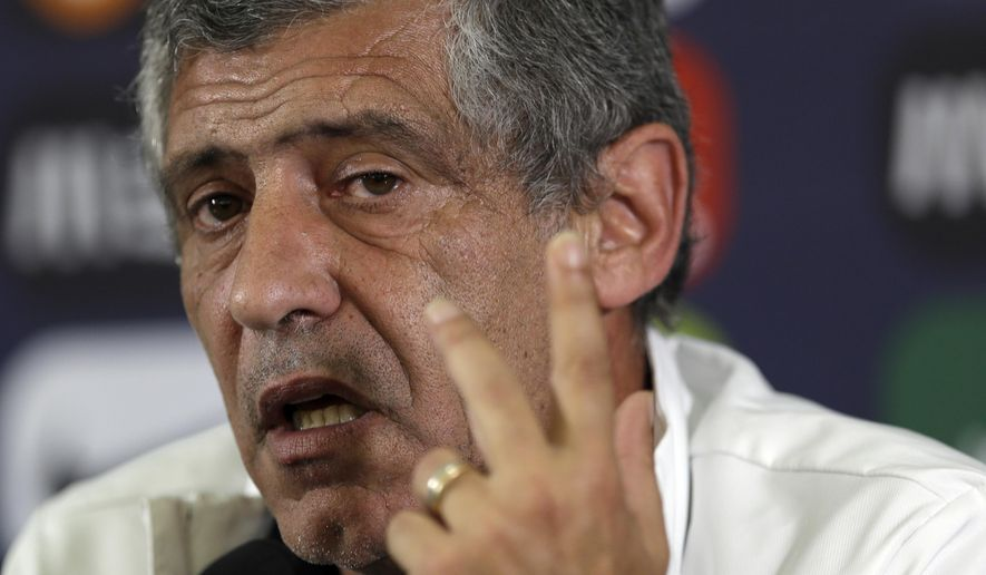 In this photo taken, May 30, 2014, Portuguese soccer coach Fernando Santos talks to journalists during a news conference at the National stadium, in Oeiras, near Lisbon. Fernando Santos is taking over as Portugal coach, despite his eight-game international ban for misconduct at the World Cup. (AP Photo/Francisco Seco)