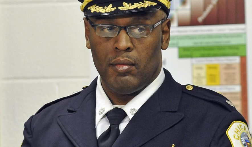 FILE - This Jan. 8, 2013 file photo shows Chicago Police Commander Glenn Evans at a CAPS program event in Chicago. The decorated Chicago police commander, accused of sticking his gun down the throat of a suspect and threatening to kill him, pleaded not guilty on Wednesday, Sept. 24, 2014, to felony counts of aggravated battery and official misconduct. Evans was arrested in August and indicted this month by a grand jury on the felony charges, stripped of his police powers by the department and put on paid administrative duty.  (AP Photo/Sun-Times Media, Brian Jackson)  MANDATORY CREDIT, MAGS OUT, NO SALES