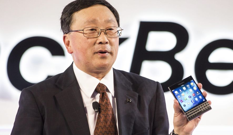 BlackBerry CEO John Chen shows off the company's new Passport device at a launch event in Toronto on Wednesday, Sept. 24, 2014. (AP Photo/The Canadian Press, Chris Young)