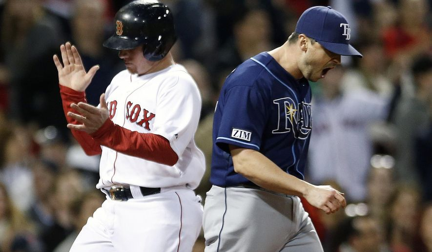 Tampa Bay Rays' Brandon Gomes, right, reacts as Boston Red Sox's Christian Vazquez, left, scores on a two-run double by Xander Bogaerts during the fourth inning of a baseball game in Boston, Wednesday, Sept. 24, 2014. (AP Photo/Michael Dwyer)