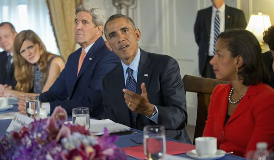 President Obama, flanked by Secretary of State John Kerry and National Security Adviser Susan Rice, speaks  during his meeting with the representatives of Bahrain, Qatar, Saudi Arabia, Jordan, United Arab Emirates and Iraq in New York, Tuesday, Sept. 23, 2014. (Associated Press) ** FILE **