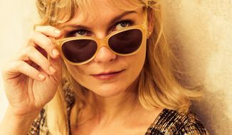 "In this image released by Magnolia Pictures, Kirsten Dunst appears in a scene from ""The Two Faces of January."" (AP Photo/Magnolia Pictures)"