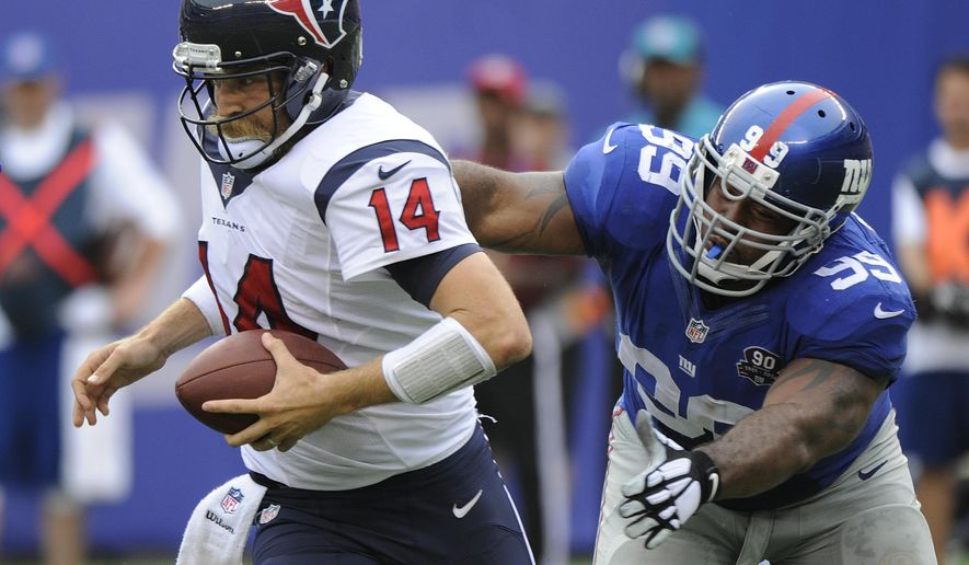 Houston Texans quarterback Ryan Fitzpatrick (14) slips out of the pocket under pressure New York Giants defensive tackle Cullen Jenkins (99) in the fourth quarter of an NFL football game, Sunday, Sept. 21, 2014, in East Rutherford, N.J. (AP Photo/Bill Kostroun)