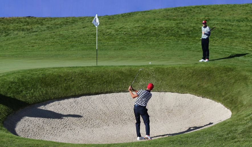 Rickie Fowler of the US plays out of the bunker onto the 18th green during a practice round ahead of the Ryder Cup golf tournament at Gleneagles, Scotland, Wednesday, Sept. 24, 2014. (AP Photo/Scott Heppell)