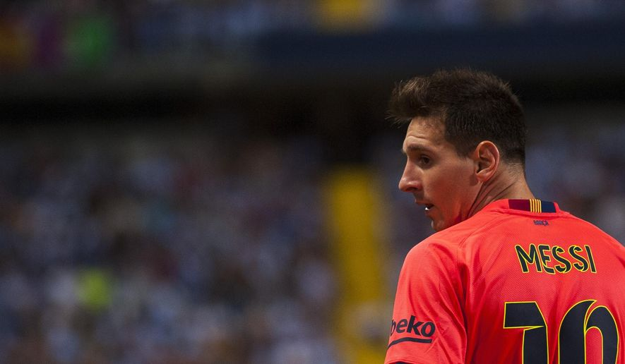 FC Barcelona's Lionel Messi from Argentina, during a Spanish La Liga soccer match between Malaga and Barcelona at La Rosaleda stadium in Malaga, Spain, Wednesday, Sept. 24, 2014. (AP Photo/Daniel Tejedor)
