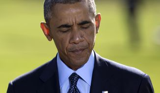 "President Barack Obama pauses as he speaks about the participation of five Arab nations in airstrikes against militants in Syria., Tuesday, Sept. 23, 2014, on the South Lawn the White House, in Washington, before heading to the United Nations. The president said the participation of five Arab nations in airstrikes against militants in Syria ""makes it clear to the world this is not America's fight alone.""  (AP Photo/Carolyn Kaster)"