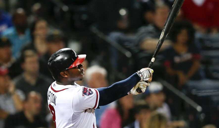 Atlanta Braves' Justin Upton follows through an two-run home run in the fourth inning of a baseball game against the Pittsburgh Pirates Wednesday, Sept. 24, 2014, in Atlanta. (AP Photo/John Bazemore)