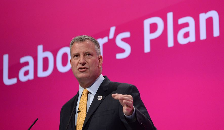Mayor of New York City Bill de Blasio, addresses the Labour Party conference in Manchester, England, Wednesday, Sept. 24, 2014. (AP Photo/PA, Stefan Rousseau)  UNITED KINGDOM OUT  NO SALES  NO ARCHIVE