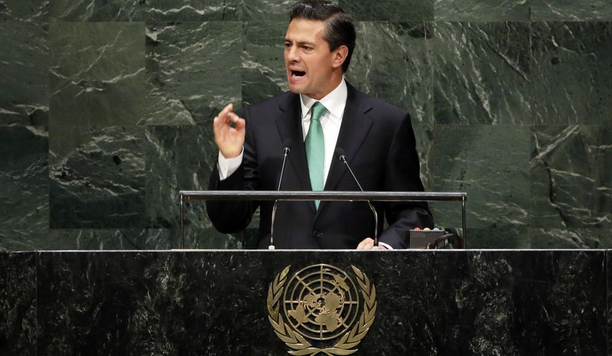 President Enrique Pena Nieto, of Mexico, addresses the 69th session of the United Nations General Assembly, at U.N. headquarters, Wednesday, Sept. 24, 2014. (AP Photo/Richard Drew)