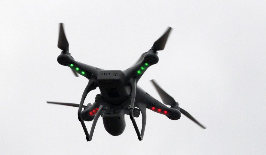 In this March 12, 2014, file photo, a drone prepares to land after flying over the scene of an explosion that leveled two apartment buildings in East Harlem in New York. (AP Photo/Mark Lennihan, File)