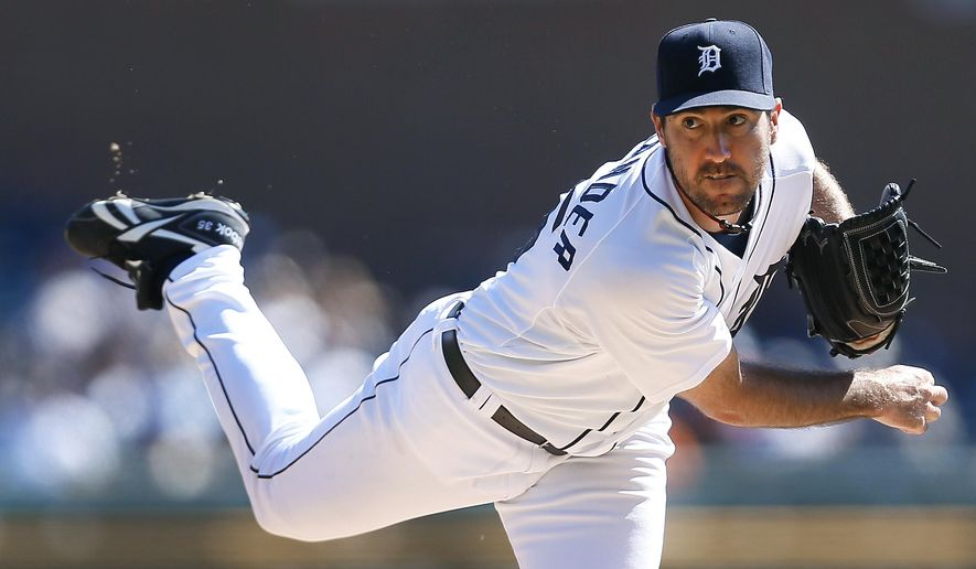 Detroit Tigers pitcher Justin Verlander throws against the Chicago White Sox in the first inning of a baseball game in Detroit Wednesday, Sept. 24, 2014. (AP Photo/Paul Sancya)
