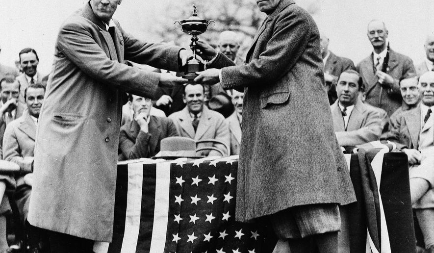 FILE - In this April 23, 23, 1929 file photo, Samuel Ryder presents the Ryder Cup to George Duncan, the captain of the British team who beat the U.S., in Leeds, England. Ryder was an English businessman and was the inspiration behind the golf competition that bore his name. It was first contested in 1927 between the United States and Britain. The US won the inaugural competition. (AP Photo, File)