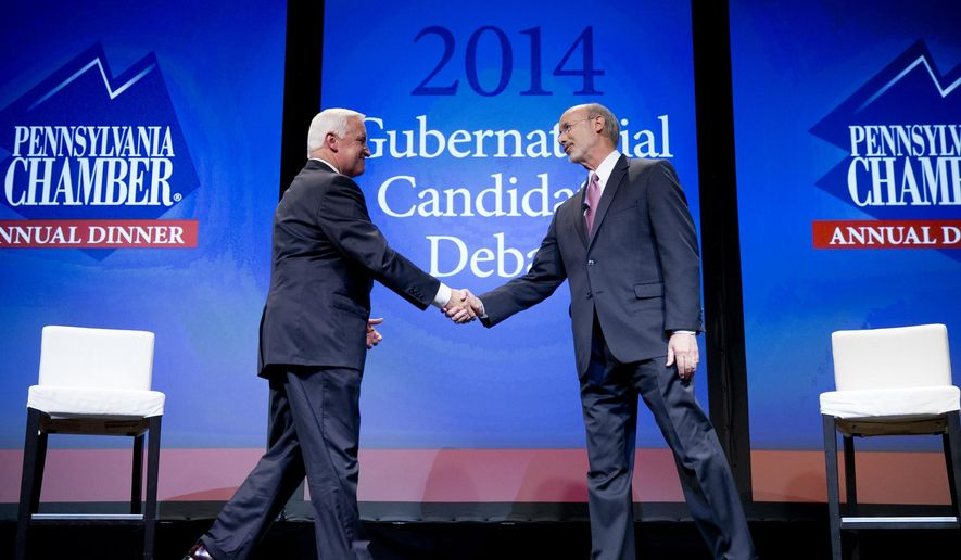 FILE - In this Monday, Sept. 22, 2014, file photo, Republican Gov. Tom Corbett, left, and Democrat Tom Wolf shake hands at the end of a gubernatorial debate hosted by the Pennsylvania Chamber of Business and Industry, in Hershey, Pa. A new national survey shows Pennsylvania leads the nation in spending on TV ads by candidates for statehouse offices and their allies. The Washington-based Center for Public Integrity survey released Wednesday Sept. 24, 2014  shows the $37.8 million spent by the candidates for governor, lieutenant governor and Legislature exceeded any other state. Close behind were Texas at $36.8 million and Florida at $33.7 million. (AP Photo/Matt Rourke)