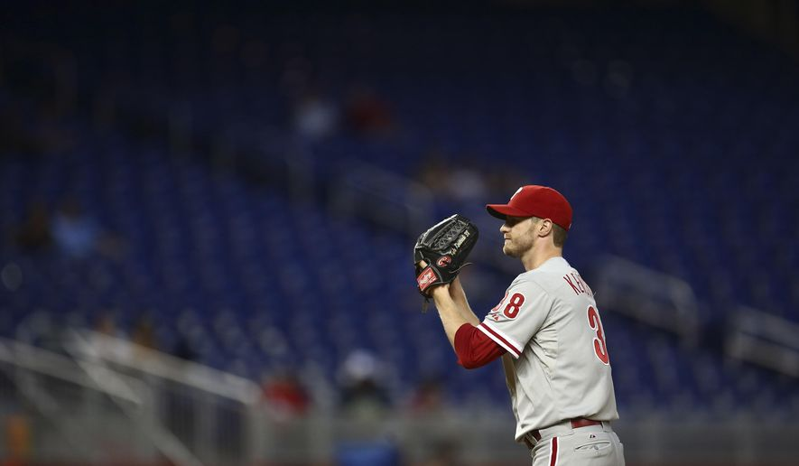 Philadelphia Phillies starter Kyle Kendrick prepares to pitch to the Miami Marlins during the first inning of a baseball game in Miami, Wednesday, Sept. 24, 2014. (AP Photo/J Pat Carter)