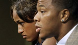 In this May 23, 2014, photo, Janay Rice, left, looks on as her husband, Baltimore Ravens running back Ray Rice, speaks to the media during a news conference in Owings Mills, Md. The Ravens terminated their contract with Ray Rice, Sept. 8, 2014, hours after a video surfaced on TMZ's website of him punching his fiancee, Janay. (AP Photo/Patrick Semansky, File)