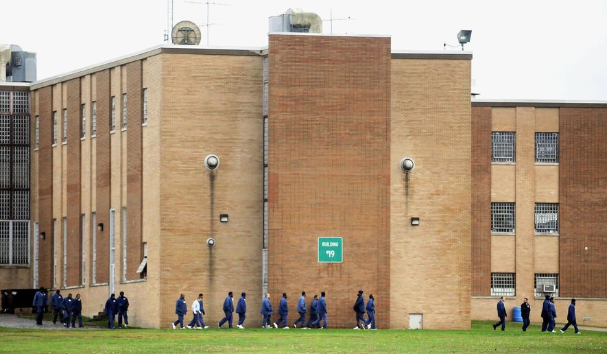 This Oct. 19, 2011 photo shows inmates exiting building No. 19 at the Vienna Correctional Center in Vienna, Ill.  Two federal judges may visit the southern Illinois prison as they work on a class-action lawsuit that inmates brought about overcrowding, according to court documents.  U.S. Magistrate Judge Philip M. Frazier in a Tuesday, Sept. 23, 2014, order called for a meeting with lawyers for both the state and the inmates at the facility on Oct. 30. (AP Photo/The Southern, Steve Jahnke)