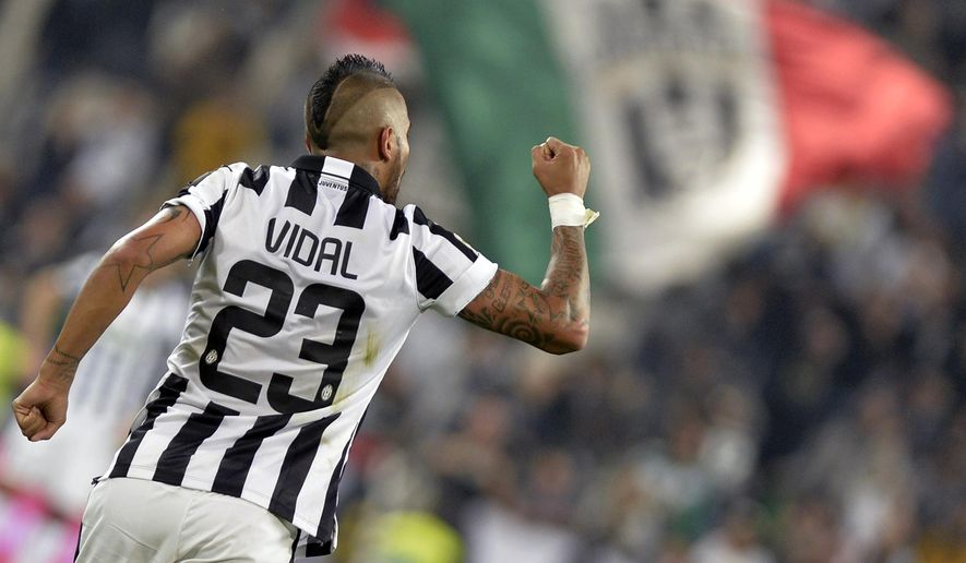 Juventus Arturo Vidal celebrates after scoring during a Serie A soccer match between Juventus and Cesena at the Juventus stadium, in Turin, Italy, Wednesday, Sept. 24, 2014. (AP Photo/Massimo Pinca)