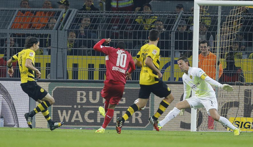 Stuttgart's Daniel Didavi, second from left, scores during the German first division Bundesliga soccer match between BvB Borussia Dortmund  and VfB Stuttgart in Dortmund, Germany, Wednesday, Sept. 24, 2014. (AP Photo/Frank Augstein)