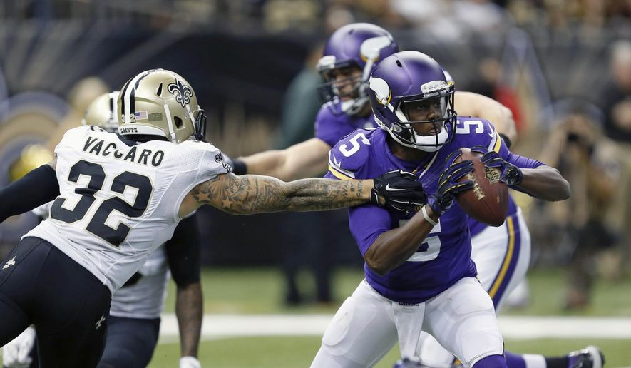 New Orleans Saints strong safety Kenny Vaccaro (32) pressures Minnesota Vikings quarterback Teddy Bridgewater (5) in the second half of an NFL football game in New Orleans, Sunday, Sept. 21, 2014. (AP Photo/Rogelio Solis)