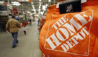 In this Feb. 22, 2010, file photo, shoppers walk through the aisles at the Home Depot store in Williston, Vt. (AP Photo/Toby Talbot, File)