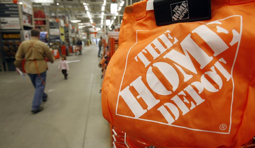FILE - In this Feb. 22, 2010, file photo, shoppers walk through the aisles at the Home Depot store in Williston, Vt. Home Depot said Thursday that malicious software lurking in its check-out terminals between April and September affected 56 million debit and credit cards that customers swiped at its stores. Target, Michaels and Neiman Marcus have also been attacked by hackers in the past year. (AP Photo/Toby Talbot, File)