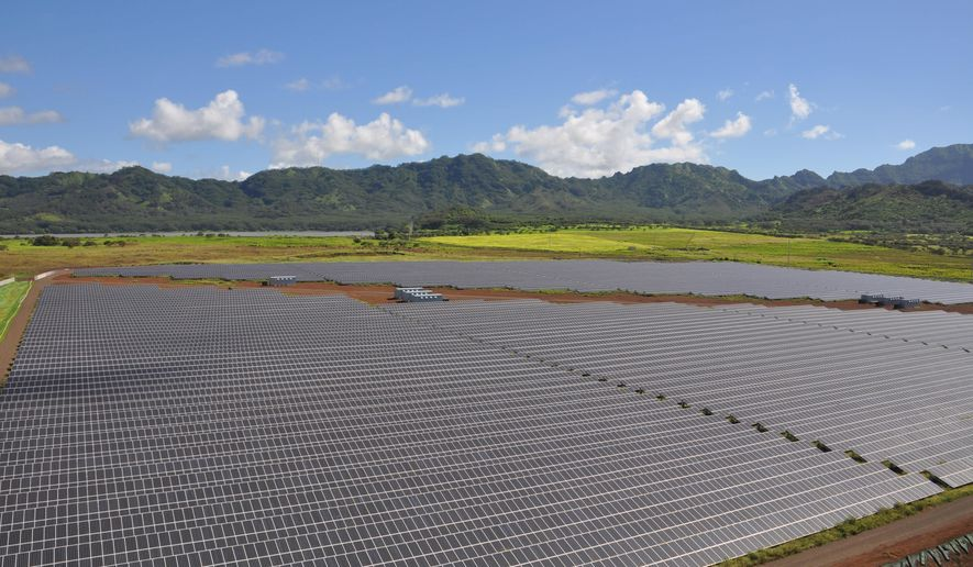 This Aug. 12, 2014 photo provided by the  Kauai Island Utility Cooperative shows Hawaii's largest solar farm, which the  Kauai Island Utility Cooperative is opening to the public this weekend, in Koloa, Hawaii. The solar array went into full commercial operation starting this month. (AP Photo/Shelley Paik, Kauai Island Utility Cooperative)