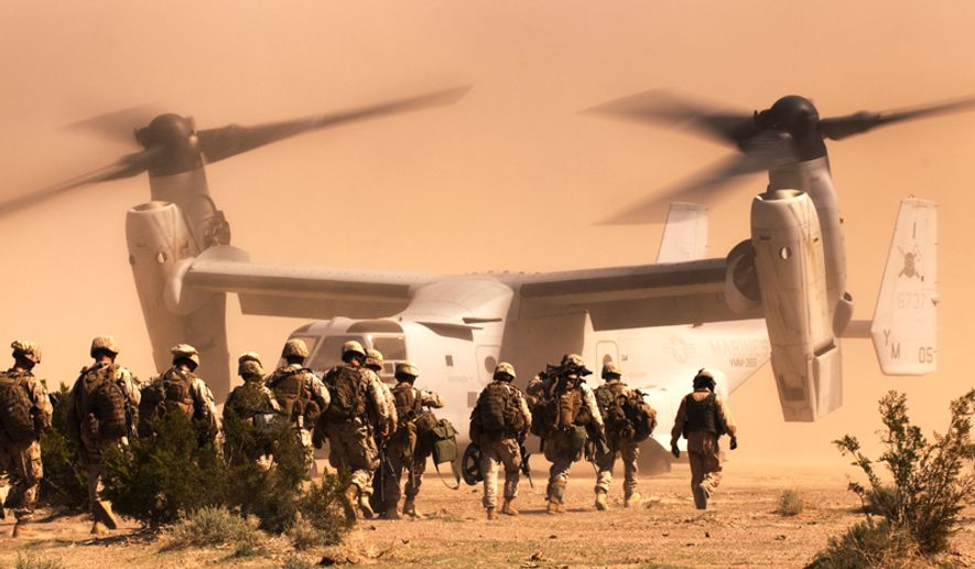 Marines and sailors from India Company, 3rd Battalion, 3rd Marine Regiment, head for a Marine Medium Tiltorotor Squadron 365 MV-22 Osprey at Marine Corps Air Ground Combat Center Twentynine Palms, Calif. (Image: U.S. Marine Corps) ** FILE **
