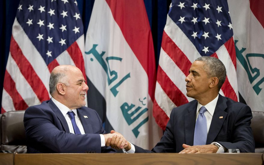 President Obama shakes hands with Iraqi Prime Minister Haider al-Abadi following their bilateral meeting at U.N. headquarters, Wednesday, Sept. 24, 2014. (AP Photo/Pablo Martinez Monsivais)