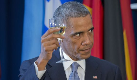 President Obama raises his glass to toast during a luncheon hosted by U.N. Secretary General Ban Ki-moon on Sept. 24, 2014, at the United Nations headquarters. (Associated Press) **FILE**