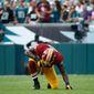 Washington Redskins' Brian Orakpo takes a knee during the second half of an NFL football game against the Philadelphia Eagles, Sunday, Sept. 21, 2014, in Philadelphia. (AP Photo/Matt Rourke)