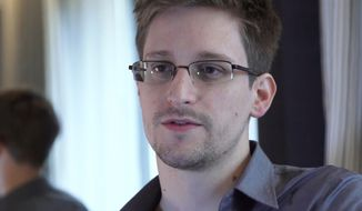 In this June 9, 2013, file photo provided by The Guardian Newspaper in London shows Edward Snowden, who worked as a contract employee at the National Security Agency, in Hong Kong. (AP Photo/The Guardian, Glenn Greenwald and Laura Poitras, File)