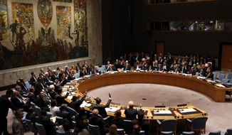 The United Nations Security Council votes to unanimously adopt a draft resolution regarding the threat of foreign terrorist fighters during the 69th session of the U.N. General Assembly at U.N. headquarters, Wednesday, Sept. 24, 2014. (AP Photo/Jason DeCrow)