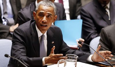 U.S. President Barack Obama addresses a meeting of the United Nations Security Council regarding the threat of foreign terrorist fighters during the 69th session of the U.N. General Assembly at U.N. headquarters, Wednesday, Sept. 24, 2014. (AP Photo/Jason DeCrow)