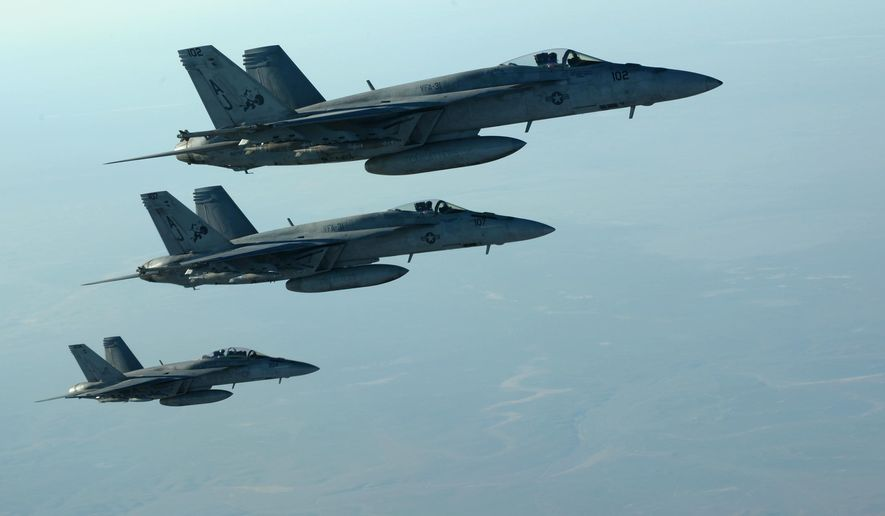 In this Tuesday, Sept. 23, 2014 photo released by the U.S. Air Force, a formation of U.S. Navy F-18E Super Hornets leaves after receiving fuel from a KC-135 Stratotanker over northern Iraq, as part of U.S. led coalition airstrikes on the Islamic State group and other targets in Syria. U.S.-led airstrikes targeted Syrian oil installations held by the militant Islamic State group overnight and early Thursday, Sept. 25, 2014, killing nearly 20 people as the militants released dozens of detainees in their de facto capital, fearing further raids, activists said. (AP Photo/U.S. Air Force, Staff Sgt. Shawn Nickel)