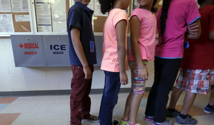 Detained immigrant children line up in the cafeteria at the  Karnes County Residential Center,  a temporary home for immigrant women and children detained at the border, in Karnes City, Texas. (AP Photo/Eric Gay, File)