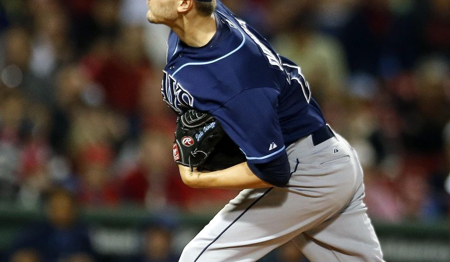 Tampa Bay Rays' Jake Odorizzi pitches during the first inning of a baseball game against the Boston Red Sox in Boston, Wednesday, Sept. 24, 2014. (AP Photo/Michael Dwyer)