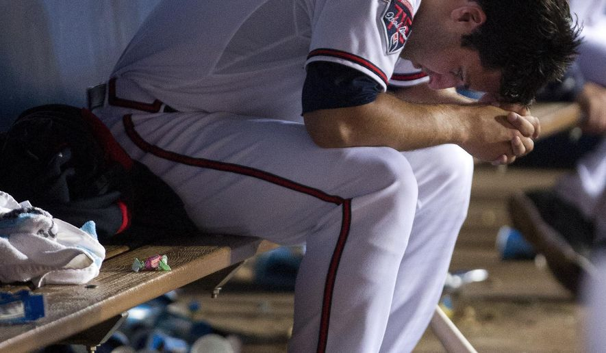 Atlanta Braves relief pitcher David Hale sits on the bench after being relieved in the fourth inning of a baseball game against the Pittsburgh Pirates, Thursday, Sept. 25, 2014, in Atlanta. (AP Photo/John Bazemore)