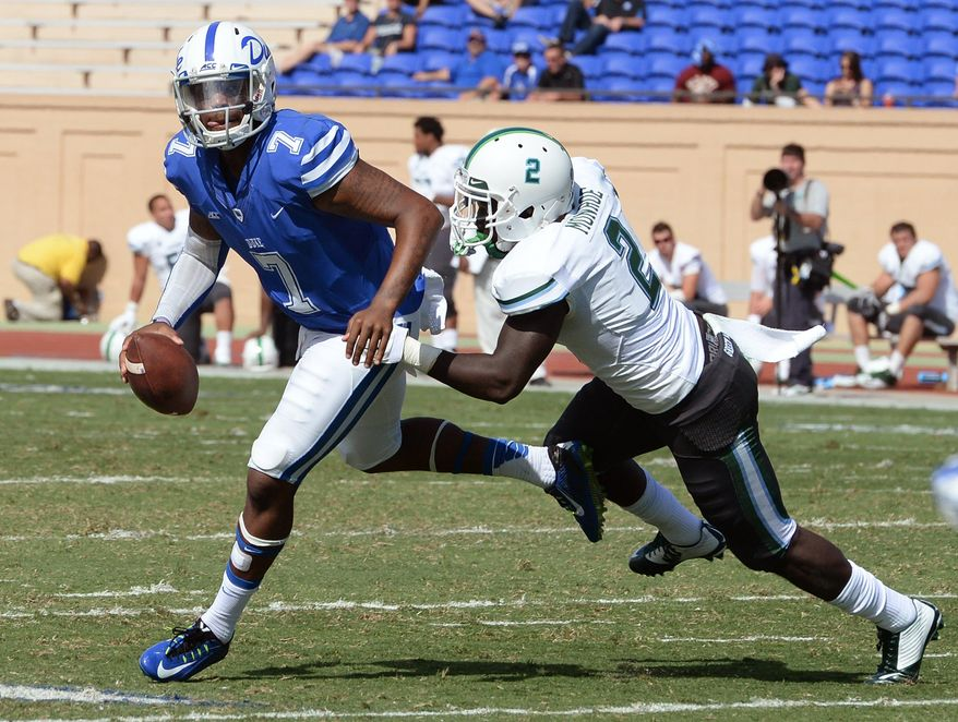 Duke quarterback Anthony Boone (7) tries to evade Tulane safety Darion Monroe (2) in the third quarter, Saturday, Sept. 20, 2014 at Wallace Wade Stadium in Durham, N.C.. Duke defeated Tulane 47-13 to remain perfect at 4-0. (AP Photo/The News & Observer, Chuck Liddy) MANDATORY CREDIT