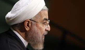 President Hassan Rouhani of Iran addresses the 69th session of the United Nations General Assembly at U.N. headquarters, Thursday, Sept. 25, 2014. (AP Photo/Jason DeCrow)