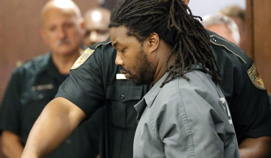 Jesse Leroy Matthew Jr. is escorted into a courtroom for an appearance before 405th District Court Judge Michelle Slaughter regarding his extradition back to Virginia, Thursday, Sept. 25, 2014, in Galveston, Texas. Matthew was arrested on a beach in the Texas community of Gilchrist by Galveston County Sheriff's authorities Wednesday night, Sept. 24, 2014. He is charged with abducting missing University of Virginia sophomore Hannah Graham and is awaiting extradition. (AP Photo/David J. Phillip)