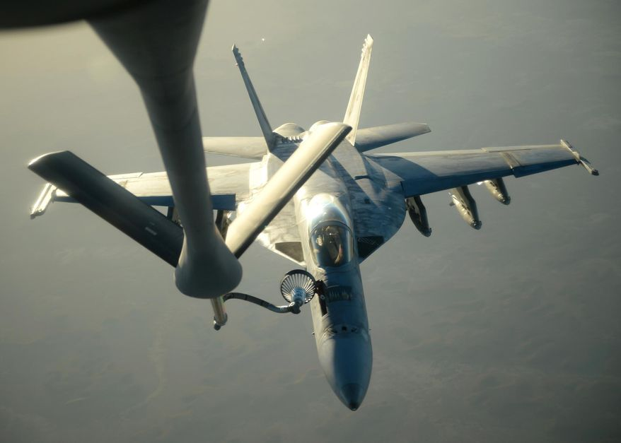 In this Tuesday, Sept. 23, 2014, file photo released by the U.S. Air Force, a U.S. Navy F-18E Super Hornet receives fuel from a KC-135 Stratotanker over northern Iraq after conducting airstrikes as part of U.S. led coalition airstrikes on the Islamic State group and other targets in Syria. (AP Photo/U.S. Air Force, Staff Sgt. Shawn Nickel)