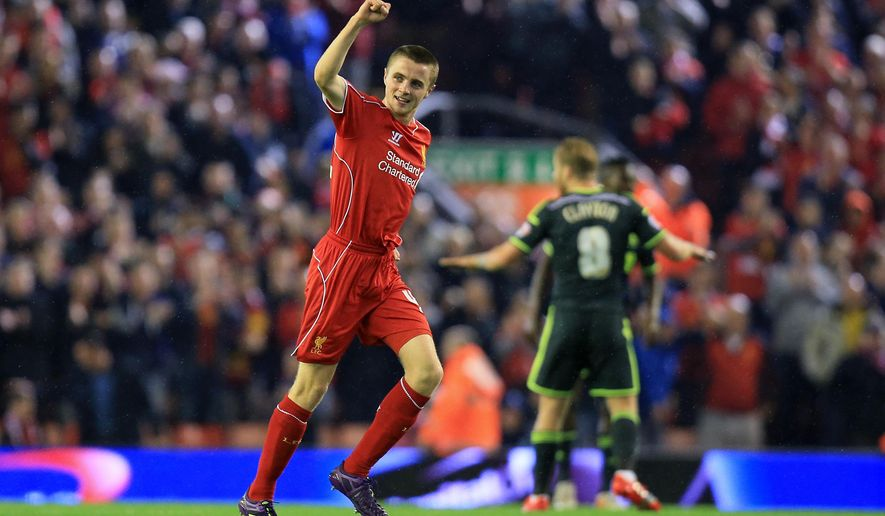 Liverpool's Jordan Rossiter celebrates the opening goal during the English League Cup Third Round match Liverpool against Middlesbrough at Anfield, Liverpool, England, Tuesday Sept. 23, 2014. (AP Photo/PA, Peter Byrne) UNITED KINGDOM OUT  NO SALES  NO ARCHIVE
