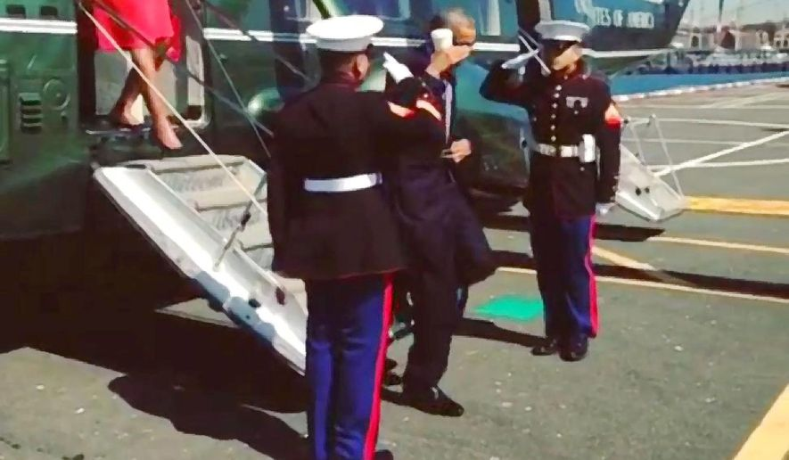 President Obama returning the salute as he leaves Marine One en route to the United Nations                     The Washington Times from a White House image