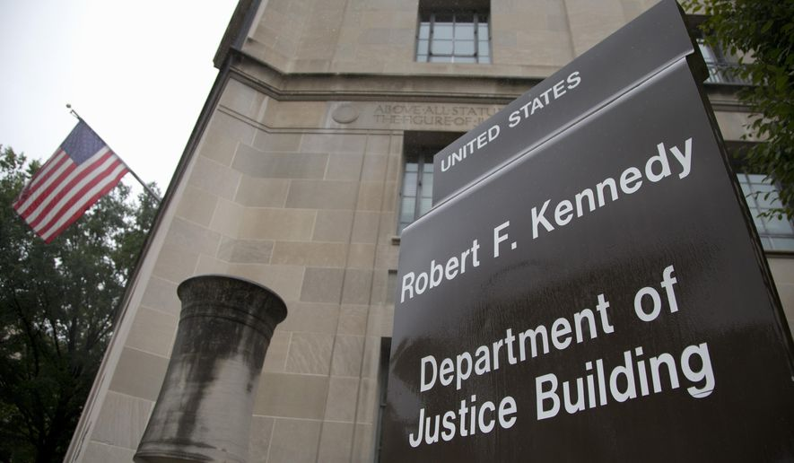 The Justice Department is seen in Washington, Thursday, Sept. 25, 2014. (AP Photo/Carolyn Kaster)