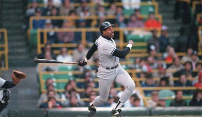 New York Yankees' Dave  Winfield hits a triple May 5,1987 during the second inning of game against Chicago White Sox pitcher Richard Dotson in Chicago. Winfield scored later in the inning. (AP Photo/John Swart)