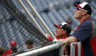 Washington Nationals bench coach Randy Knorr, left, and manager Matt Williams watch batting practice before a baseball game against the Philadelphia Phillies at Nationals Park Thursday, July 31, 2014, in Washington. (AP Photo/Alex Brandon)