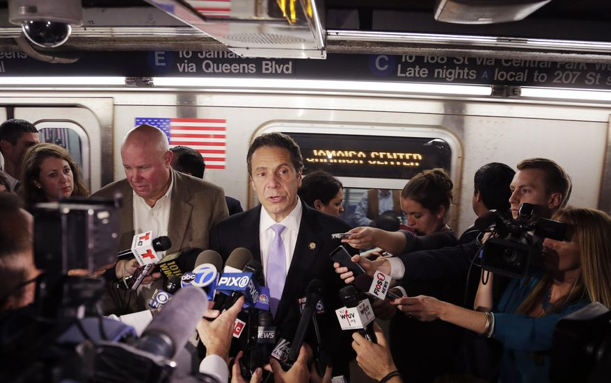 """New York Governor Andrew Cuomo holds a news conference on a subway platform, Thursday, Sept. 25, 2014 in New York. The governor says New York is acting with """"the utmost precaution"""" following a report of a possible plot against U.S. subway systems. Iraq's prime minister said Thursday that captive militants had told his country's intelligence agents about an alleged plot targeting subway systems in the U.S. and Paris. (AP Photo/Mark Lennihan)"""