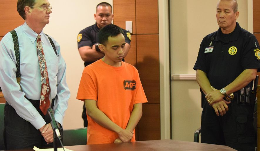 Chad DeSoto, in orange, showed no outward emotion as he is handed down three life sentences without the possibility of parole at the Superior Court of Guam in Hagatna, Guam, on Sept. 25, 2014. DeSoto was convicted last month in the slaying of three Japanese tourists and attacks on 11 other people in Tumon, Guam, on Feb. 12, 2013. (AP Photo/The Pacific Daily, Mark Scott)