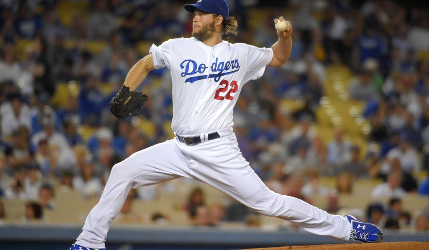 Los Angeles Dodgers starting pitcher Clayton Kershaw throws to the plate during the first inning of a baseball game against the San Francisco Giants, Wednesday, Sept. 24, 2014, in Los Angeles. (AP Photo/Mark J. Terrill)